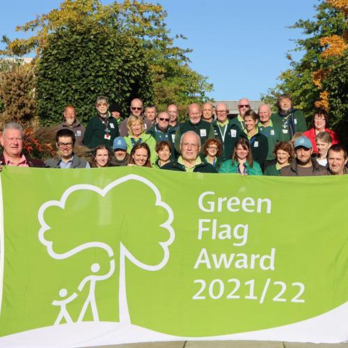 Arboretum Team holding the Green Flag