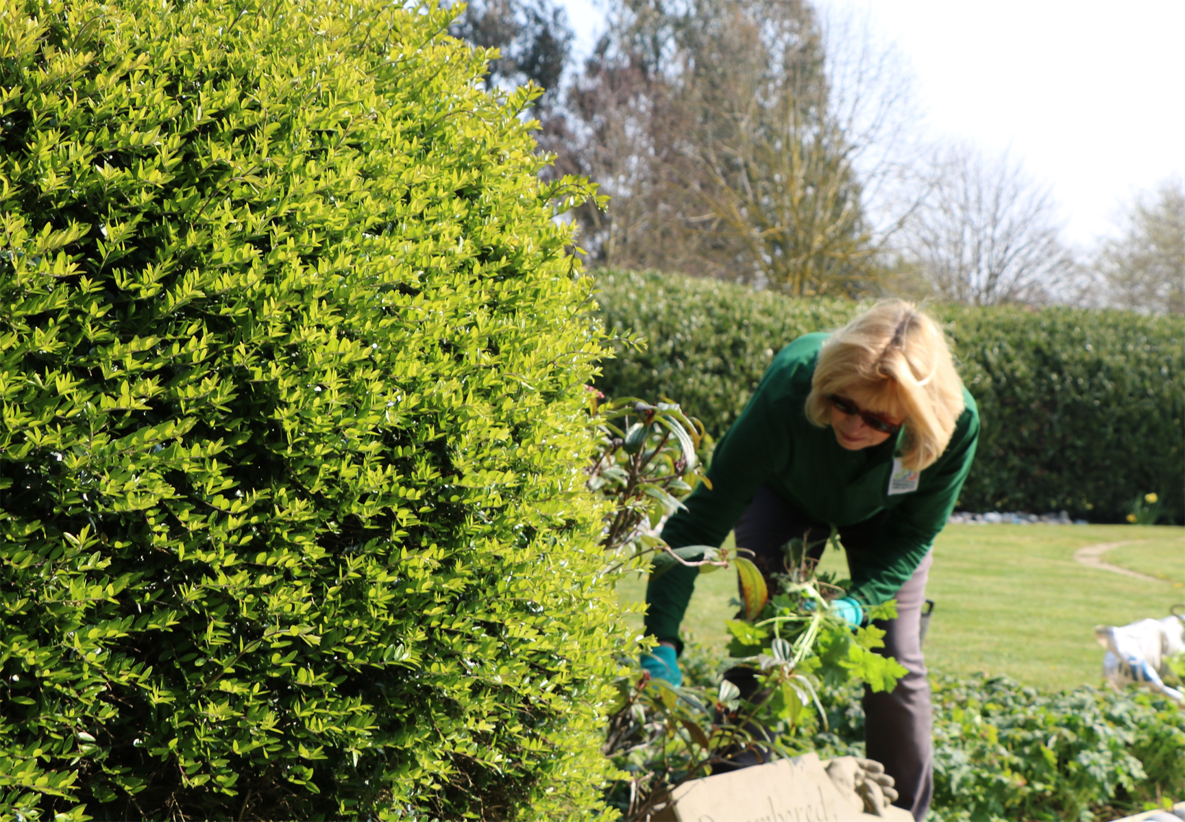 A volunteer working in the grounds.