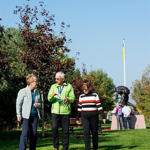 Group walking past Royal Army Medical Corps Memorial