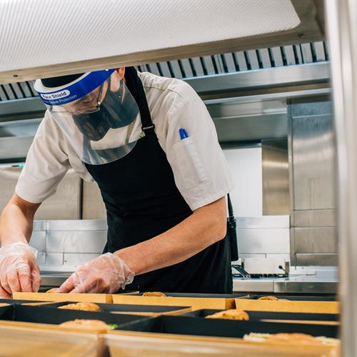 Arboretum Chef preparing food in Aspects kitchen