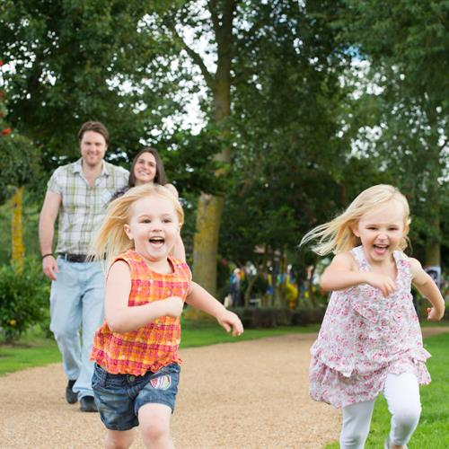 Family running along pathway